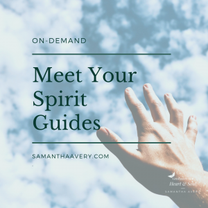 Hand reaching to blue sky indicating spirit guides